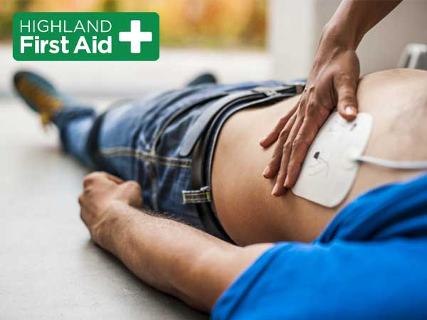 man receiving AED