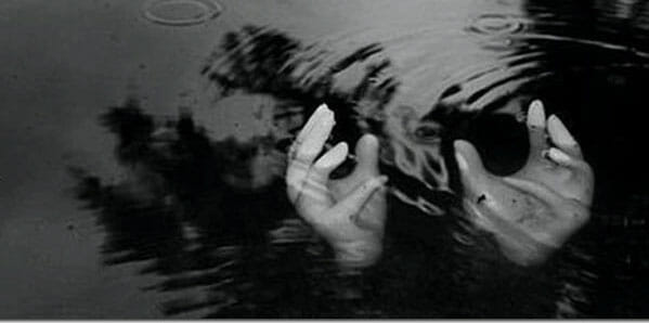 pair of hands in the water
