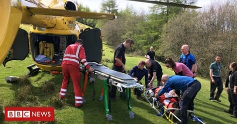 Mountain rescue team load a helicopter