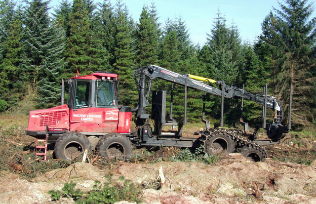 Red forestry harvesting machine