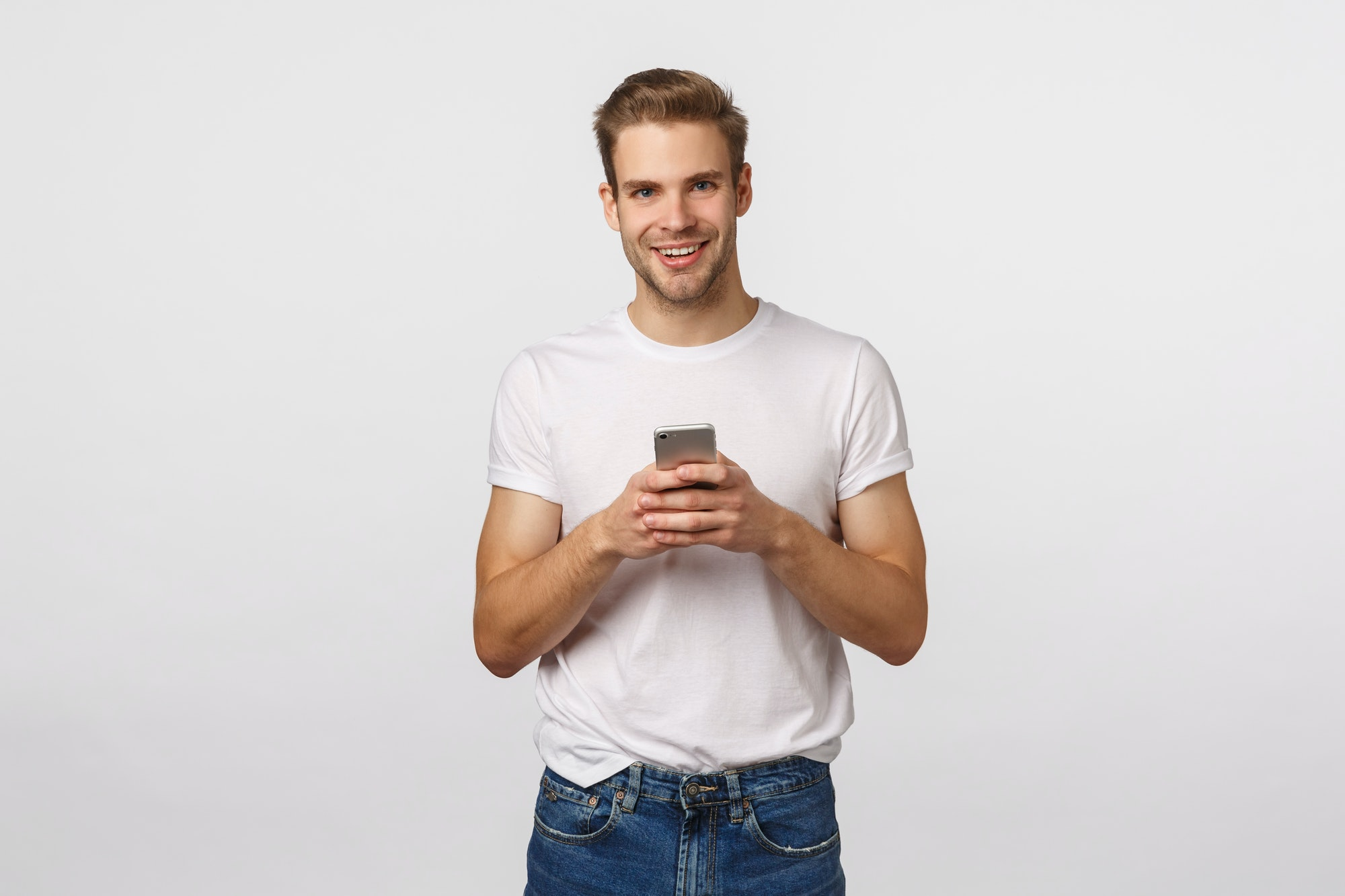 Telephone, digital modern life, technology concept. Handsome smiling blond caucasian man with
